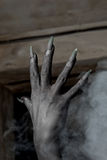 Black hands of the devil on wall background Royalty Free Stock Images