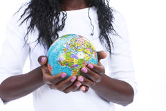 Black hands holding a world globe isolated. On white royalty free stock images