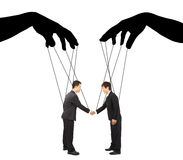 Black hands shadow control two businessman actions Royalty Free Stock Image