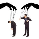 Black hands shadow control two businessman actions Stock Images