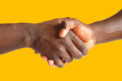 Black handshake - gold background. This is an image of two people making a handshake Stock Photography