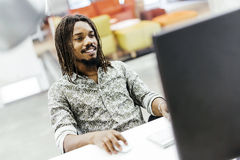 Black handsome designer workin on a computer Stock Photo