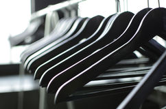 Black hangers. And clothing industry Stock Photo