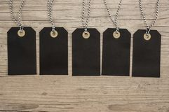 Black Hanging tags. With copy space close up stock image