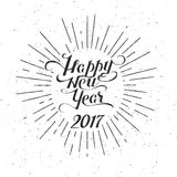 Black Happy new year 2017 vector lettering. Black vintage Happy new year 2017 vector lettering rounded sign with burst isolated on white background stock illustration