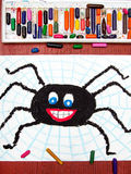 Black happy spider and spider`s web Stock Photo
