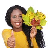 Black happy woman with colorful leaves Royalty Free Stock Photo