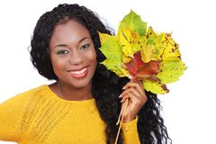 Black happy woman with colorful leaves Stock Photos