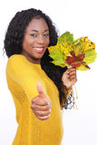Black happy woman with colorful leaves Stock Image
