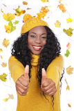 Black happy woman with colorful leaves Royalty Free Stock Images