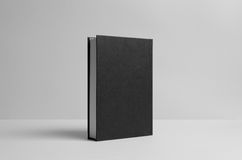 Black Hardcover Book Mock-Up - Backside. Wall Background. A photo of a Black Hardcover Book Mock-Up on a wall background Stock Images