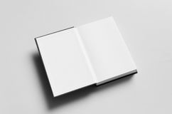 Black Hardcover Book Mock-Up - First Page. A photo of a Black Hardcover Book Mock-Up on a gray background Royalty Free Stock Images