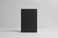 Black Hardcover Book Mock-Up - Front. Wall Background. A photo of a Black Hardcover Book Mock-Up on a wall background Stock Photos