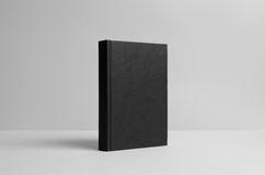 Black Hardcover Book Mock-Up - Wall Background. A photo of a Black Hardcover Book Mock-Up on a wall background Stock Photo