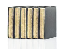 Black hardcover book on white glossy background Royalty Free Stock Image