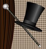 Black hat. Against the dark curtain big black man's hat and cane Stock Images