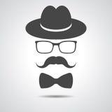 Black hat con i baffi, il farfallino ed i vetri isolati su un grey Illustrazione di Stock