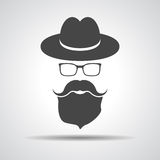 Black hat with mustache, beard and glasses isolated on a grey ba Stock Photo