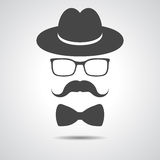 Black hat with mustache, bow tie and glasses isolated on a grey Stock Photo