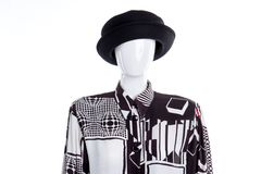 Black hat and patterned blouse for women. Female headgear and shirt on mannequin. Woman fashion wardrobe royalty free stock photos
