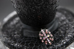Black Hat with Pink Pin. Black glitter hat with pink crystal pin Stock Photos