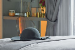 Black hat setting on bed with modern classic style bedroom. Black hat setting on bed with modern classic style interior bedroom Stock Photography