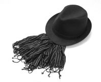 Black hat with striped muffler Stock Photography