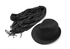 Black hat with striped muffler Royalty Free Stock Photos