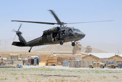 Black Hawk taking off in combat zone royalty free stock photography