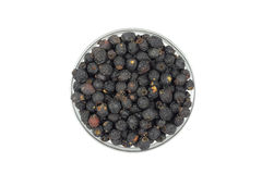 Black hawthorn berries in a glass bowl Royalty Free Stock Images