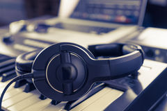 Black headphone on computer music home studio Royalty Free Stock Images