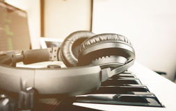 Black Headphone on Computer Music production. Set Royalty Free Stock Image