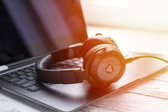 Black headphone and laptop computer Royalty Free Stock Image