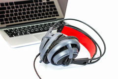 The black headphone and laptop Stock Image