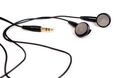 Black headphones. With wires and plug on white background Stock Photo