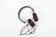 Black headphones against a light coloured background Royalty Free Stock Image