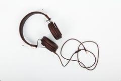 Black headphones against a light coloured background Stock Images