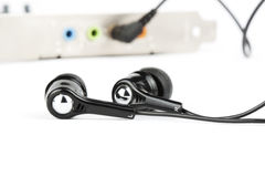 Black headphones with audio card Royalty Free Stock Photos