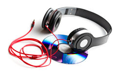 Black headphones with cd Royalty Free Stock Photos