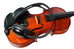 Black headphones on a classical wooden violin Royalty Free Stock Image