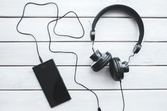 Black headphones with mobile smartphone Stock Image