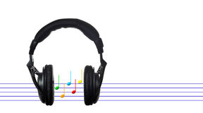 Black headphones with musical score Stock Image