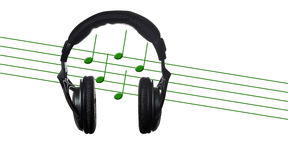 Black headphones with musical score Stock Photos
