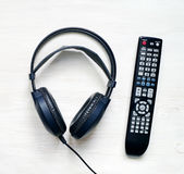 Black headphones and panel for the TV Stock Photos