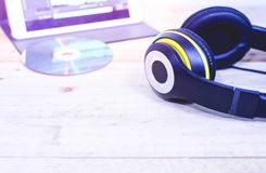 Black headphones placed on the wooden royalty free stock photos