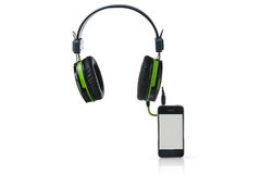 Black headphones and smart phone. Royalty Free Stock Photos