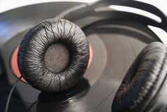 Black headphones on a vinyl record close-up Stock Photography