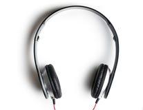 Black headphones on white background Royalty Free Stock Images