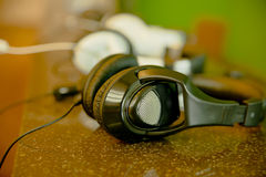 Black headset on Marble table Royalty Free Stock Image