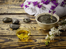 Black healing clay for Spa treatments. On the wooden table and massage oil royalty free stock photo
